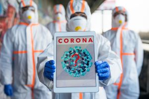 People with protective suits and respirators outdoors, coronavirus concept.