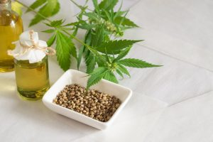 Hemp products concept. Cannabis seed oil and green plant